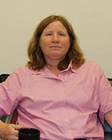Portrait image of Pamela Voekel wearing a pink shirt