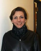 Portrait image of Lee Palmer Wandel wearing a black jacket and dark scarf.