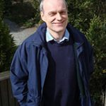 Portrait image of Max Harris outdoors wearing a blue shirt and jacket.