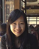 Portrait image of Laura Jo-Han Wen seated in a restaurant wearing a dark shirt.
