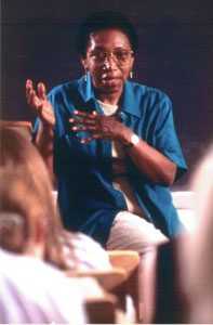 Image of Nellie Y. McKay lecturing before a class wearing a blue shirt