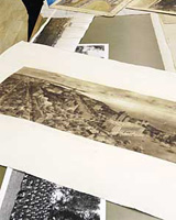 Image of a pile of black and white and sepia archival photographs