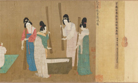 Image of Chinese scroll painting depicting 4 women pounding something white (clothing? Paper? Food?) with large wooden dowels