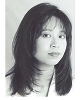 Closely-cropped black and white portrait image of Anne Cheng