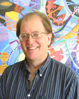 Portrait image of Craig Werner wearing glasses and a striped shirt standing in front of a colorful and bright painting