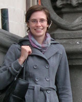 Portrait image of Erin Lambert outdoors wearing a grey coat.