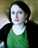 Portrait image of Eliza Zingesser wearing a green shirt
