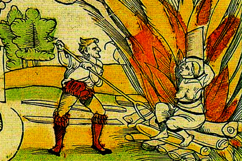 Image of a painting in warm tones of a woman being burned alive on a large pile of wood and a man poking the woman with a pitchfork