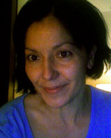 Closely-cropped portrait image of Mary Beltrán wearing a bright blue shirt