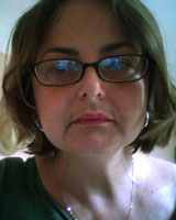 Closely-cropped portrait image of Florence Bernault wearing glasses