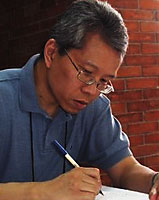 Portrait image of David Chan writing