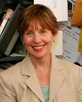 Portrait image of Leslie DeBauche in an office