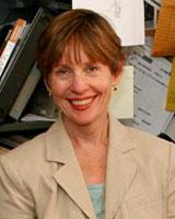 Portrait image of Leslie DeBauche in an office