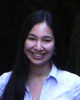 Portrait image of Beth Lew-Williams in front of a black background wearing a white shirt