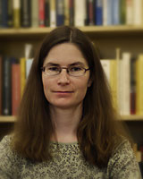 Portrait image of Andrea Westlund in front of book shelves