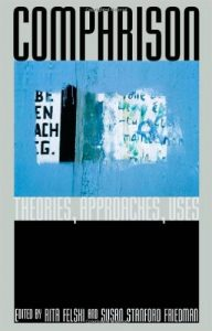 "Image of cover of book ""Comparison..."" with image of a blue and black composite image of paint and text"