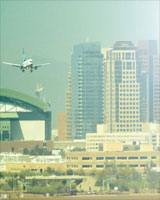 image of plane taking off against a smoggy skyline