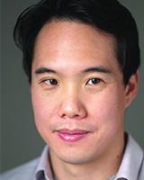 Head shot image of Charles Yu wearing a light purple shirt