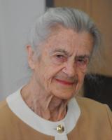 Portrait image of Ciplijauskaité wearing a tan and white shirt.