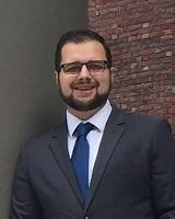 Portrait image of Daniel Hummel in front of brick wall