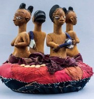 Egúngún headdress with four kneeling human figures