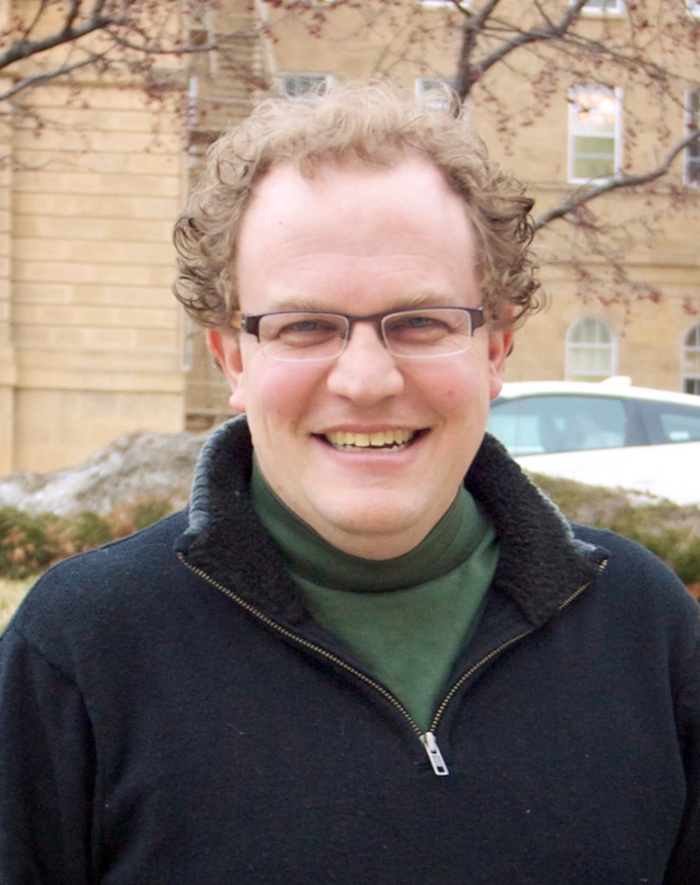 Portrait image of Jonathan Pollack outdoors wearing a black sweater