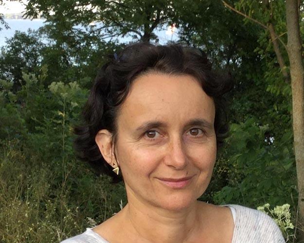 Portrait image of Florence Vatan outdoors.