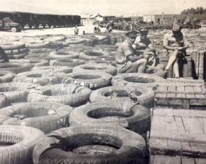 Image of the Chinese Supply Depot, Zahedan, Iran in 1943 depicting piles of tires and boxes far into the distance