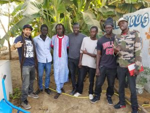 Professor D and members of Grand Yoff's Activist Mob visit G-HipHop's new community gardening project.
