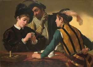 """Image of the 1594 Caravaggio painting titled """"The Cardsharps"""" showing three young men playing cards. the man in the forefront of the painting is reaching behind his back for cards in his belt."""
