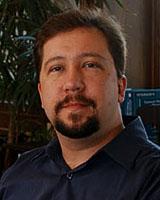 Portrait image of Michael Bailey wearing a dark blue shirt
