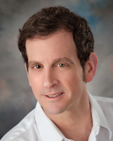 Portrait image of Russ Castronovo wearing a white shirt