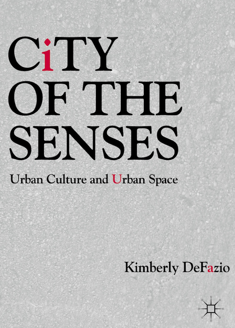 "Image of cover of book ""City of the senses..."" with black and hot pink text on a grey background"
