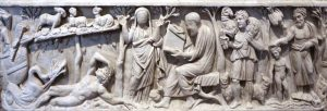 image of A sarcophagus, from Santa Maria Antiqua in Rome. Carved stone depicting multiple figures in greek robes, animals, and trees